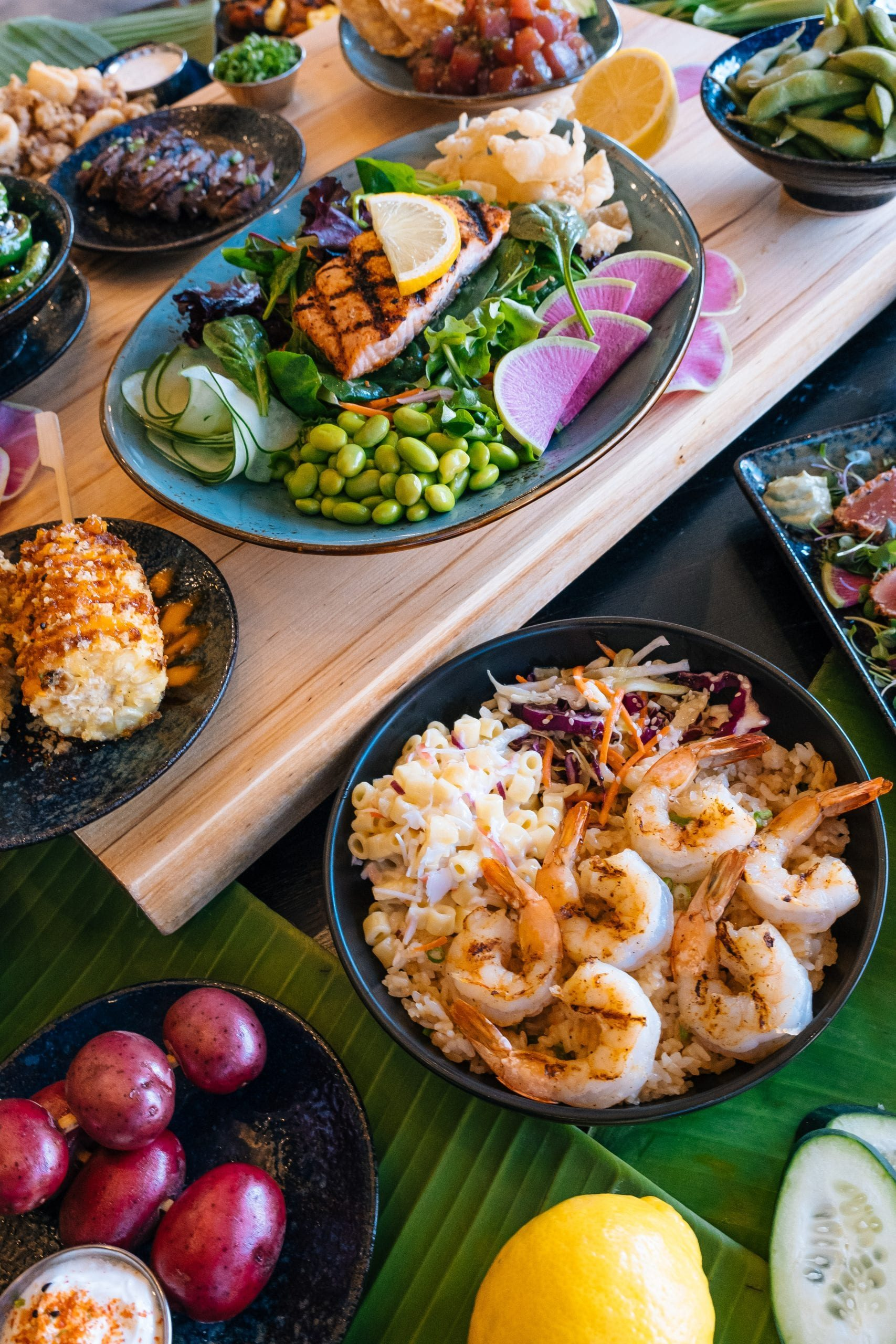 Vertical Close up of Makai Food and Poke Spread out on table