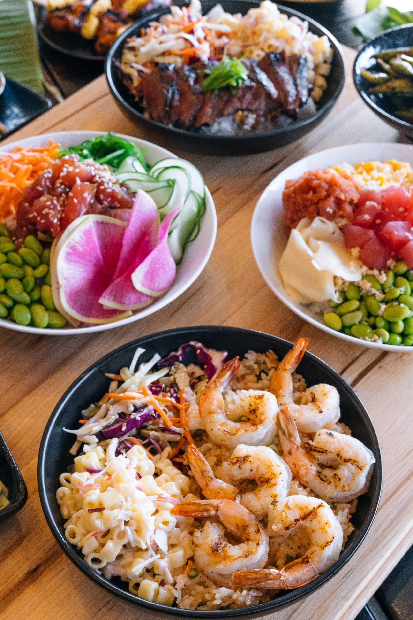 Makai Food and Poke Spread out on table - Shrimp bowl featured